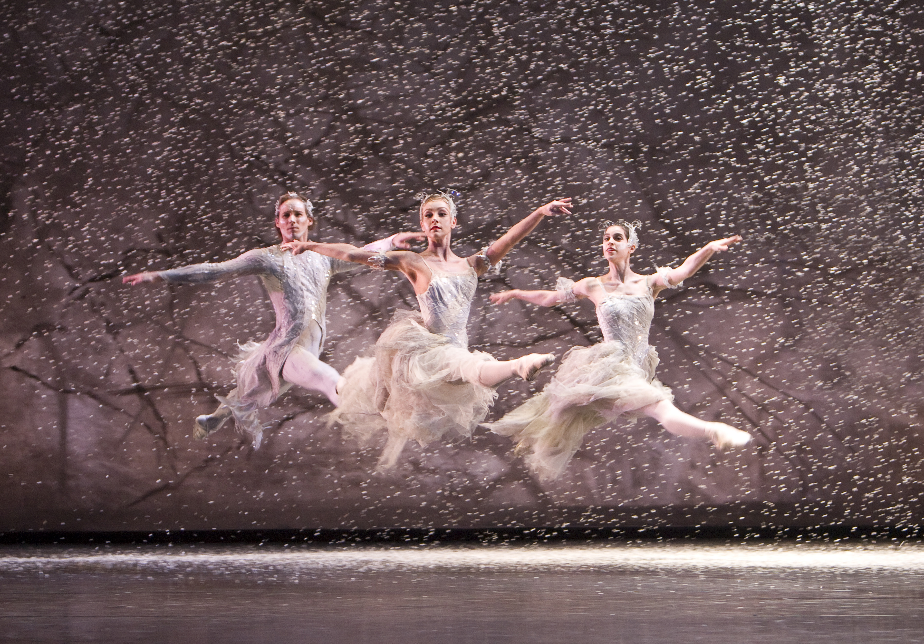 The Nutcracker: Anniek Soobroy and Marion Rainer as Snowflakes and Steven Monteith as a Wind; photo: Bill Cooper